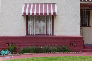 House with mauve and white awning