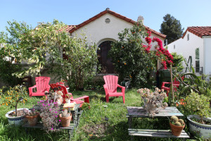 House with red lawn chairs