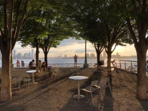 View of Hoboken from New York with the sun setting in the background